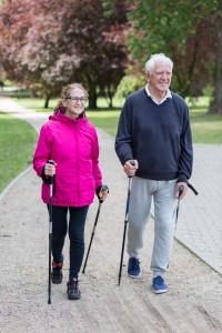 44317136 - photo of elderly couple doing nordic walking in the park